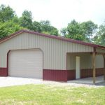 Nice residential two toned garage with inverted porch.